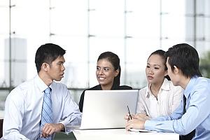 Executives sitting at table