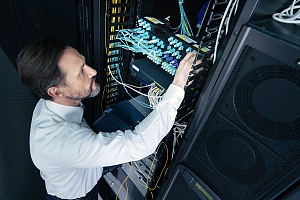 an outsourced IT service professional tending to a server rack