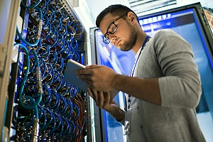 it professional working in a server room as a part of outsourced it support services