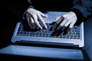 Man surfing the web on a laptop