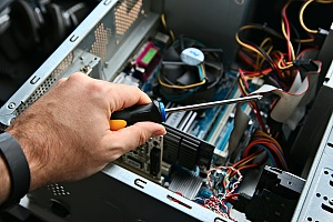 preventative maintenence performed on computer hardware by an it professional in managed it services