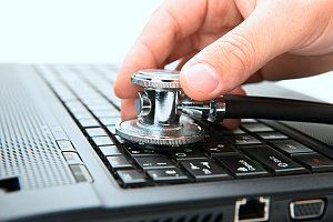 stethoscope on a laptop portraying how important computer maintenence is in managed it services