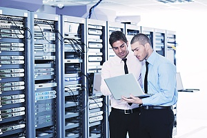 two employees at a cloud-based server hosting site