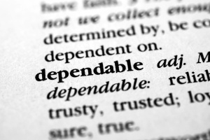 zoomed in view of the definition of the word dependable which is characteristic of a good managed it services company