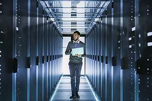 IT Technician Working in a data and IT systems.Remote data backup can be structured as either onsite or offsite