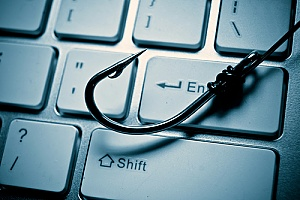 a hook on a keyboard representing phishing attacks