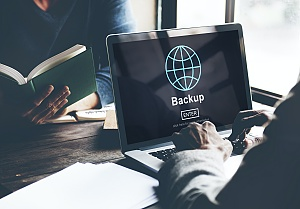 data backup shown on a business laptop as a part of managed it services in alexandria va