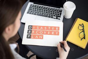 A woman working on disaster recovery plan