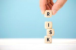 Wooden cubes with risk written on it. Depicting risk assessment and disaster recovery plan
