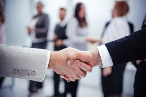Business handshake. Reach out to the experts to learn more about how MSPs support in-house IT teams