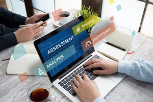 man using laptop and assessment concept