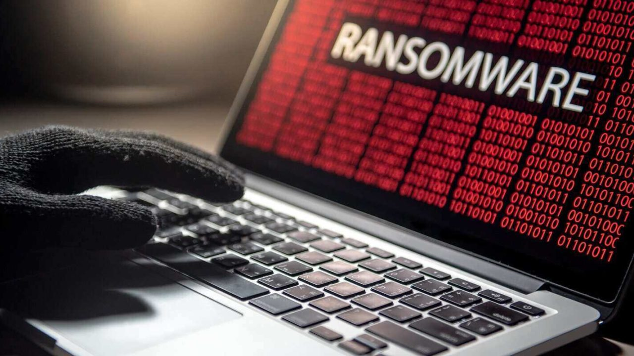 hacker hand on laptop computer keyboard