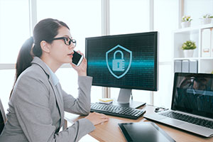 woman on phone with cybersecurity consulting